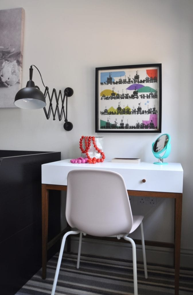 Colourful, Japanese framed wall art above a desk in a modern bedroom.