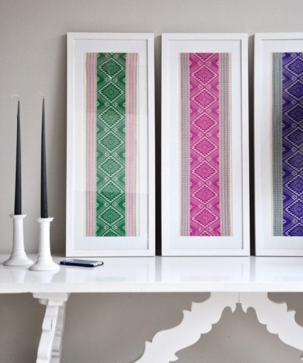Magenta pink wall art created from a hand-loombed Thai textile sourced in northern Thailand. Also available in Pea green and Regal purple.