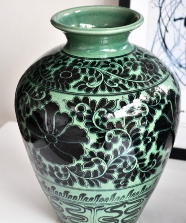 Asian pottery pot in green with hand-painted Lotus flower decoration.