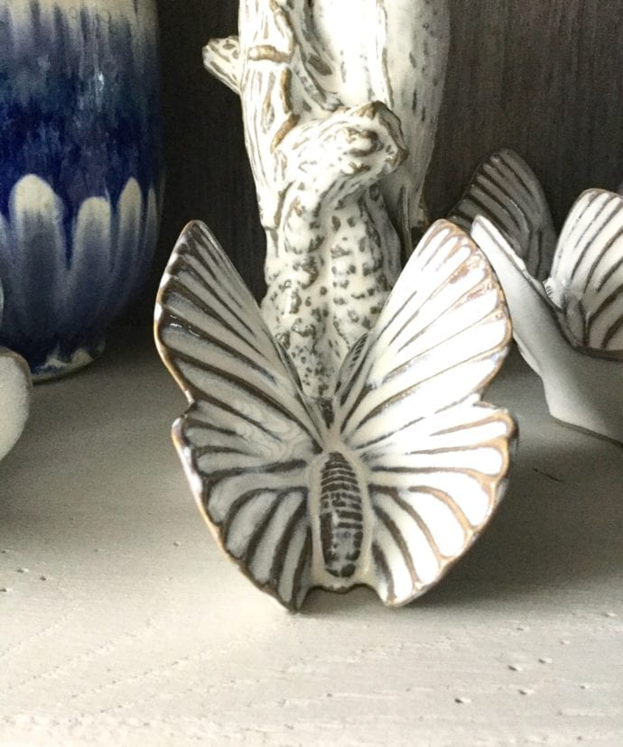 Decorative butterfly wall art in glazed white ceramic