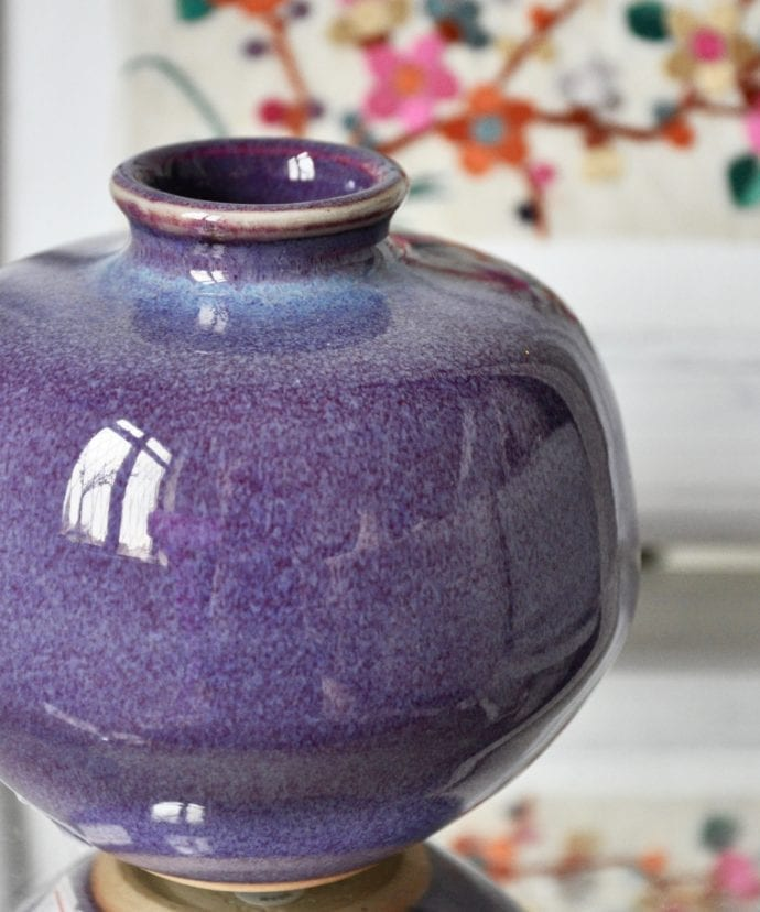 A small Oriental, glazed-ceramic, purple pot.