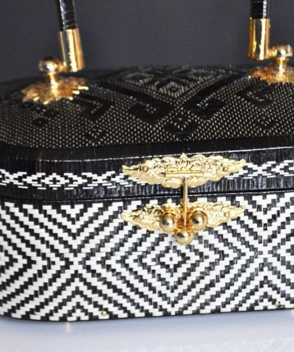 A petite woven handbag handmade in Thailand from the Lipao fern to an age old tradition.