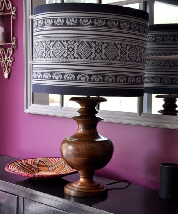 An oversized, blue and white lampshade with a Folk design inspired by traditional Hungarian dress.
