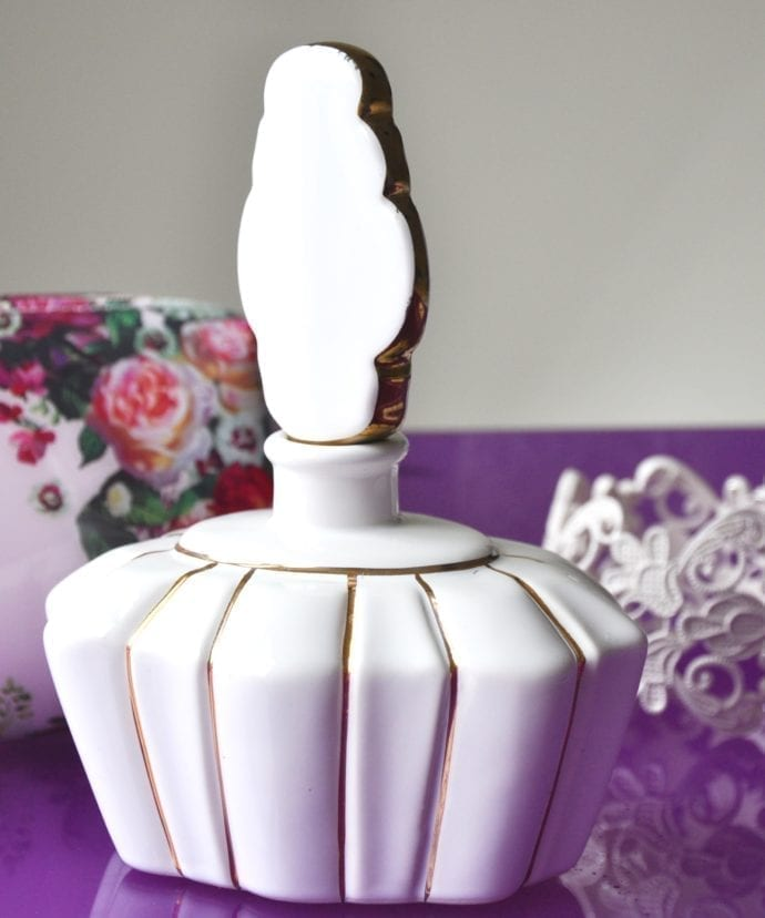 French-style white ceramic perfume bottle with scalloped stopper and gilt detailing.