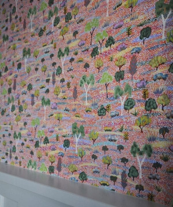 Detail of pink botanical Aboriginal art wallpaper.