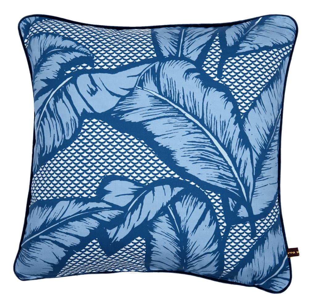 A blue banana leaf print cushion available through TelescopeStyle.com.