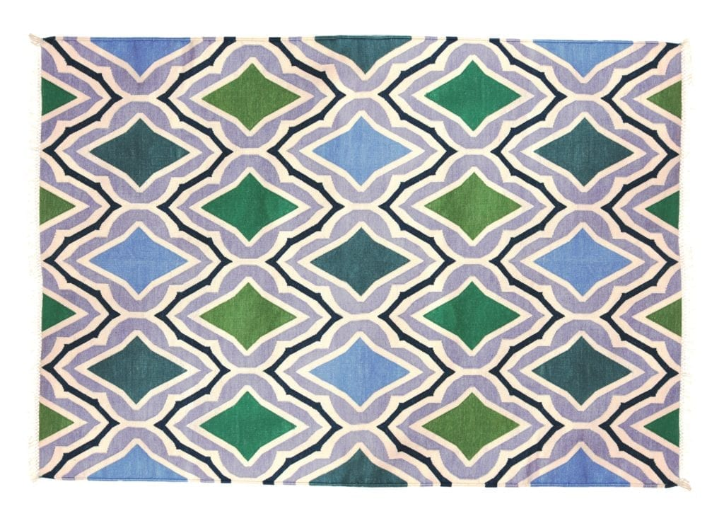 An Indian block print-inspired flat weave rug in blue and green.