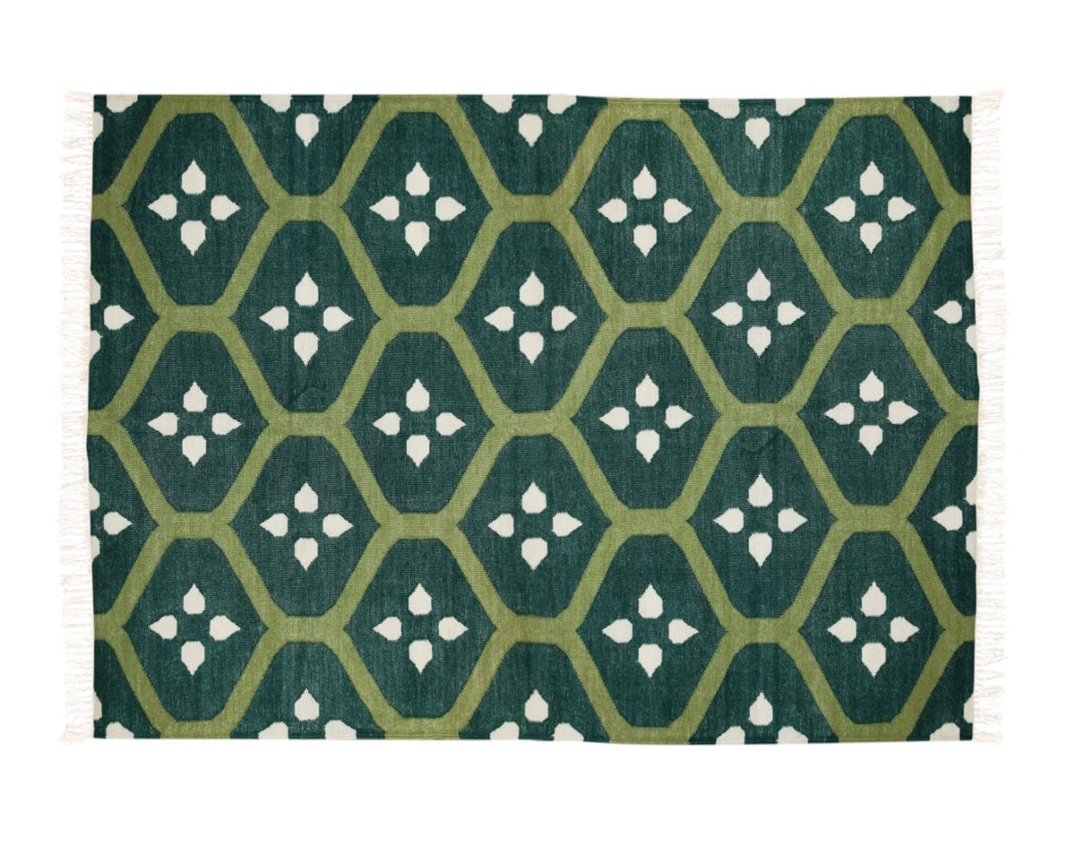 Green patterned Indian flat weave rug.