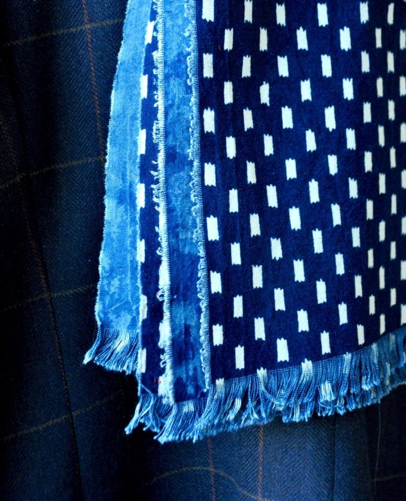 Close-up of a handmade indigo blue scarf.