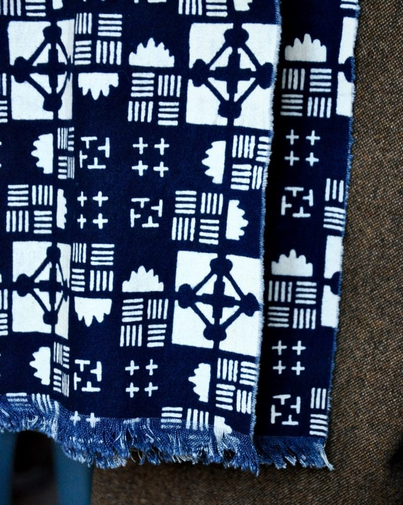 Close-up of an indigo blue geometric print scarf.
