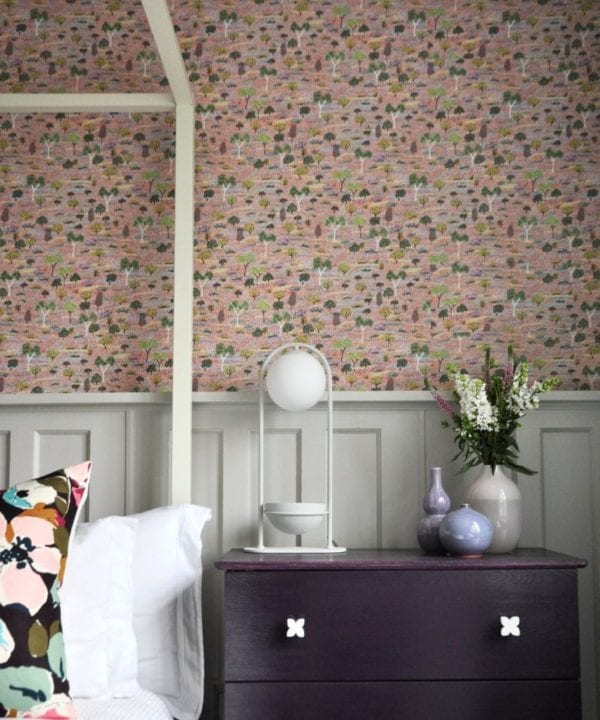 Pink trees and botanicals Aboriginal art wallpaper in a bedroom.