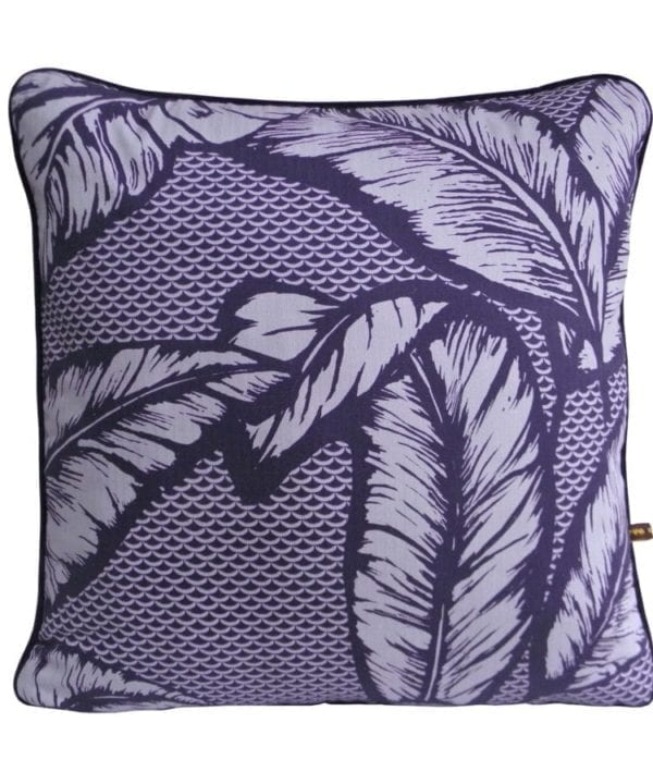 A deep purple cushion with a banana leaf print inspired by botanical gardens in Ghana.