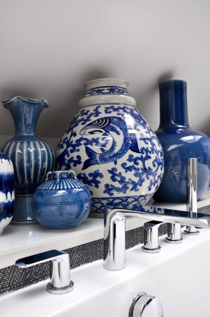 Blue and white Asian pottery in a modern bathroom.