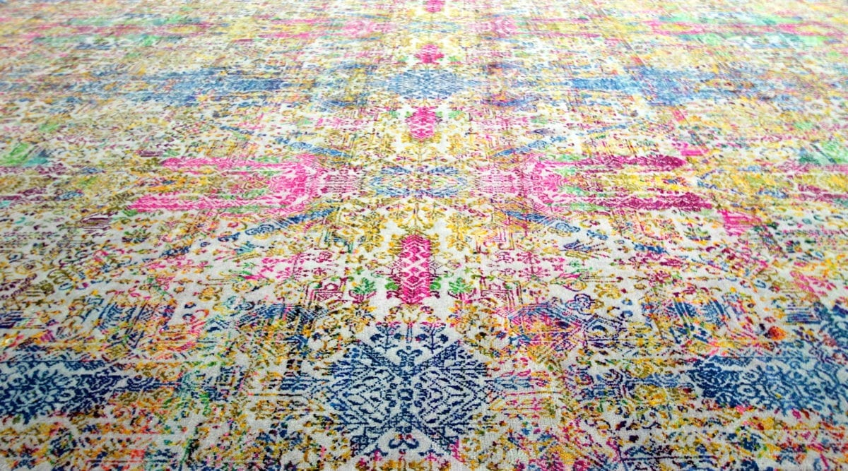 A modern, multi-coloured Persian-style rug design.