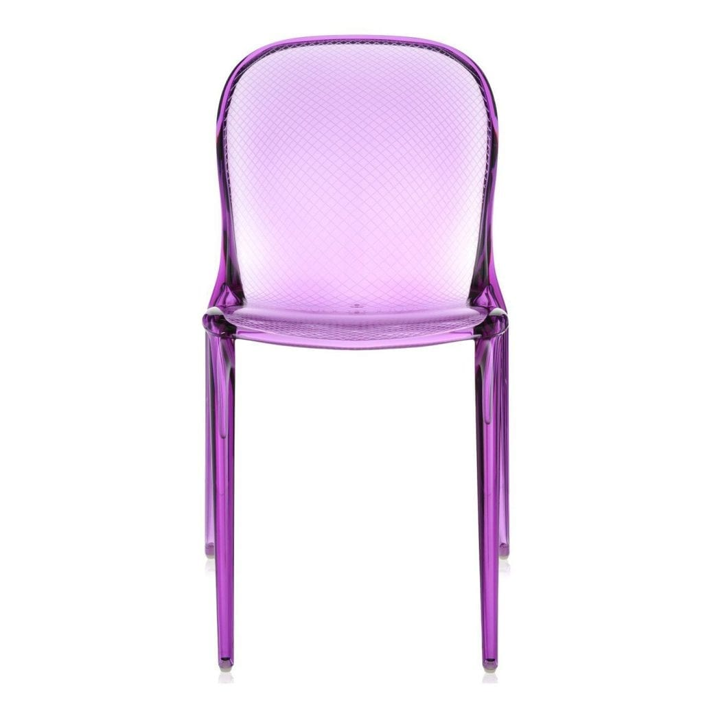 A purple see-through dining chair.