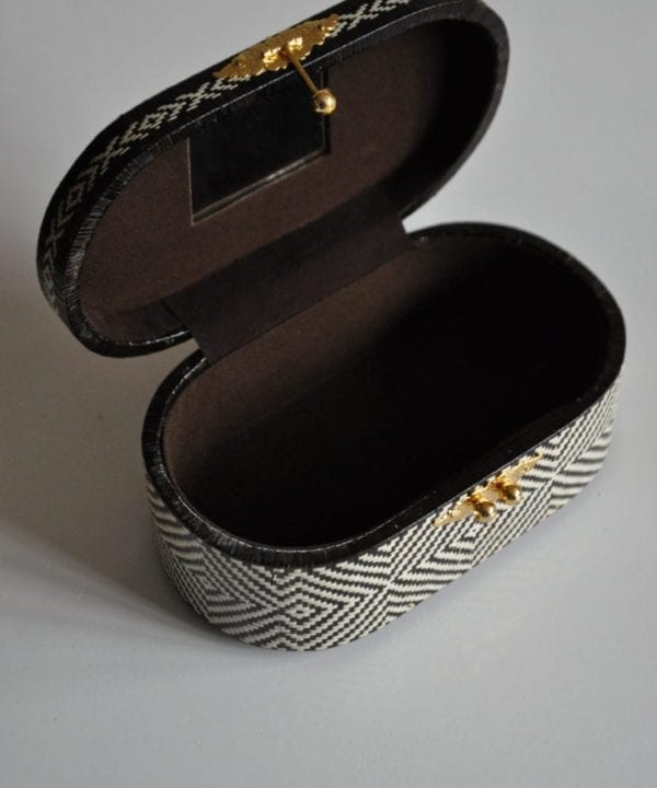 This shot shows inside the dark brown woven Thai tote bag or jewellery box.
