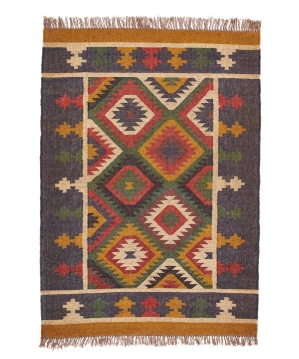 An Aztec diamond motif rug with blue borders from Telescope Style.