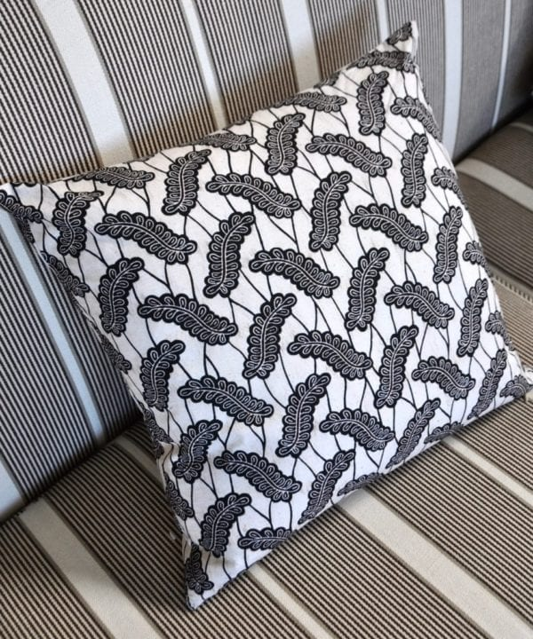 A black and white, 45cm x 45cm cushion in African Dutch wax print, available through Telescope Style.
