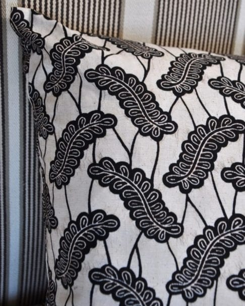 Close up shot of the African Dutch wax print botanical cushion from Telescope Style.