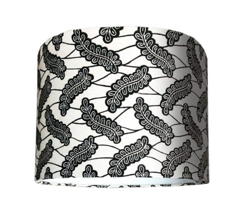 A cut-out shot of a small, monochrome lampshade in African Dutch wax print.