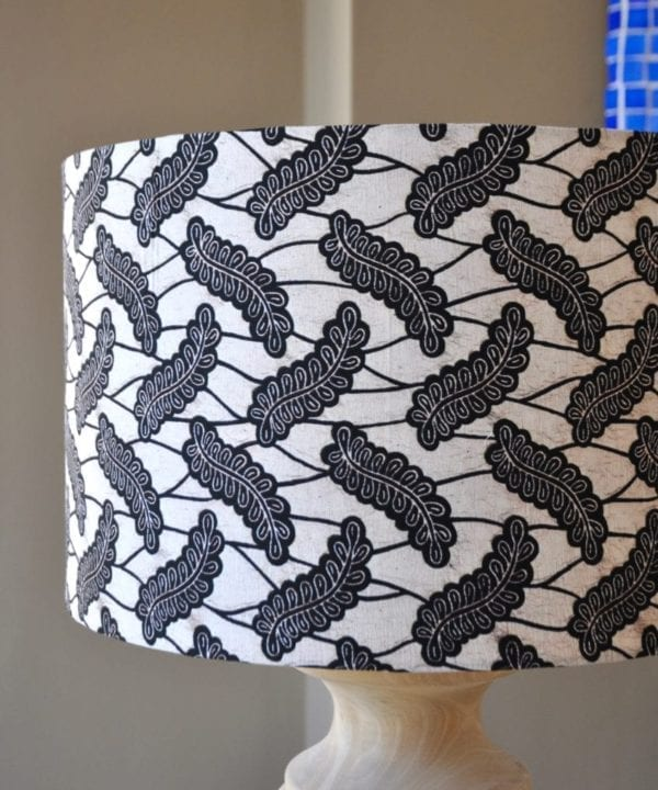 A Dutch wax print botanical fabric in monochrome on a large drum lampshade, available through Telescope Style.