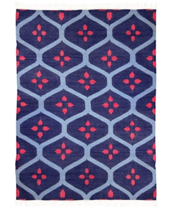 A blue and red rug with a trellis pattern.