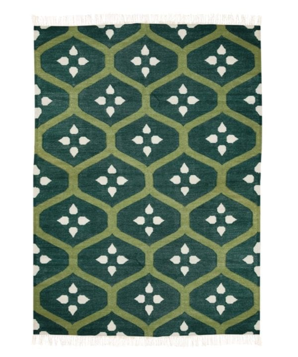A green trellis rug handmade in India. The flatweave is in a lawn green colourway.