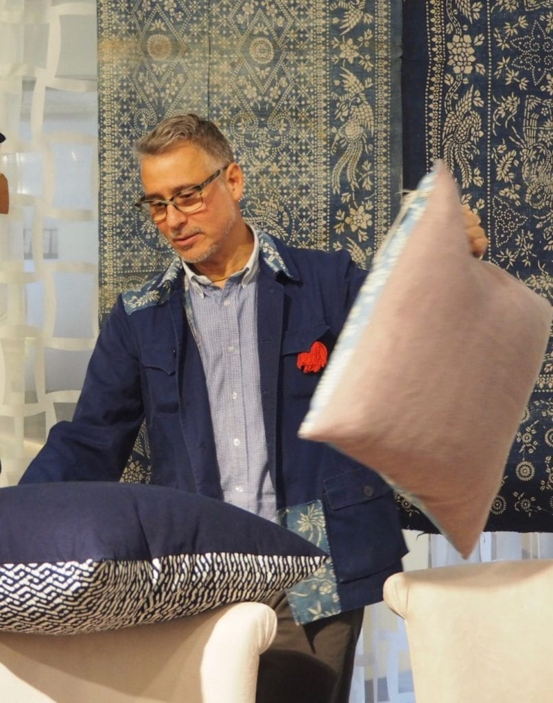 John Abbate displaying his elegant range of hand-made indigo print cushions.