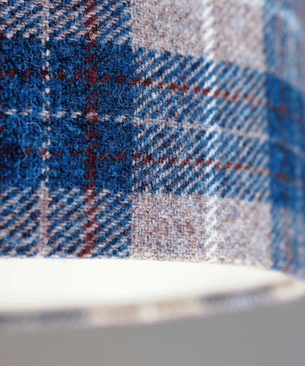Detail of a blue check Harris tweed lampshade.