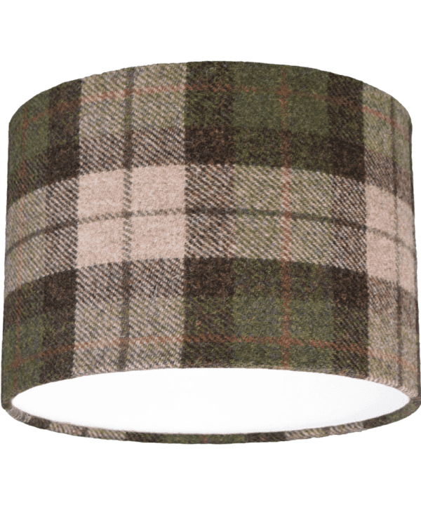 Cut out shot of a black, red and moss green check drum shade made from Harris Tweed.