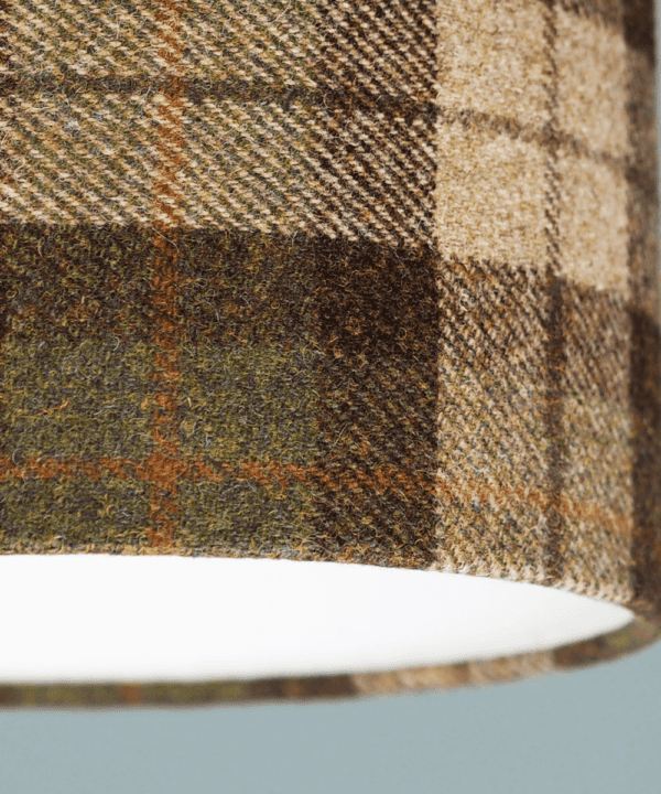 Detail of a Moss green check Harris tweed lampshade.