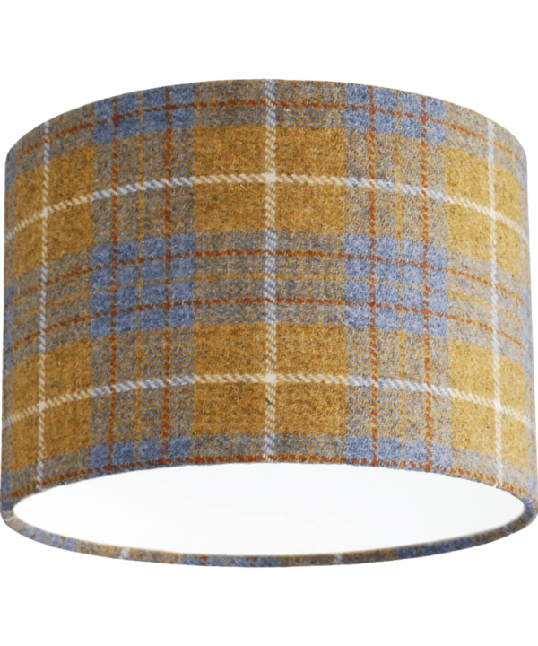 Cut out shot of a Harris tweed, grey and mustard drum shade available through Telescope Style.