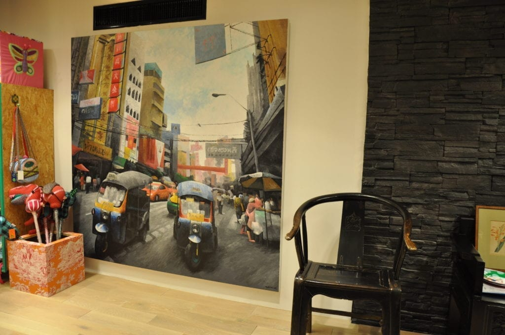A colourful canvas painting depicting the streets of Bangkok in a Thai design store.