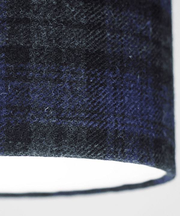 Detail shot of a Black Watch tartan drum shade made from Harris tweed.