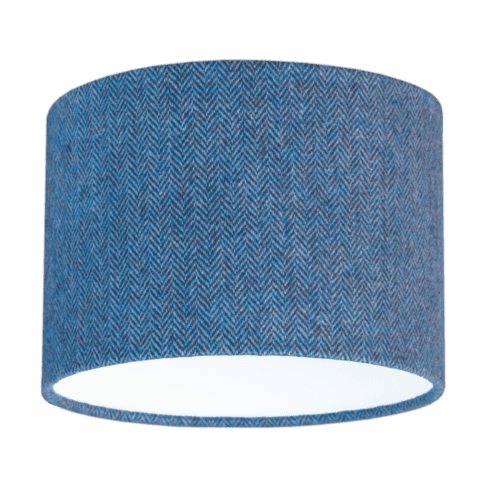 Cut out shot of a blue tweed drum shade with herringbone weave.
