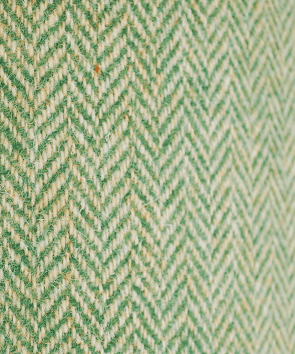 Detail of the herringbone pattern on a green tweed lampshade from the Isle of Harris.