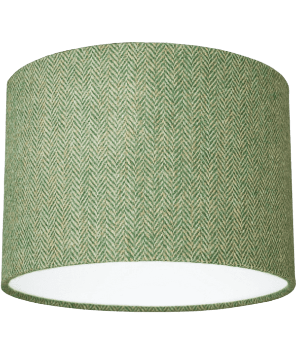 Cut out shot of a green tweed drum shade with herringbone weave.