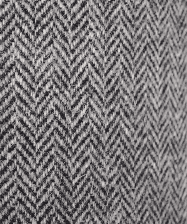 Detail of the herringbone pattern on a grey tweed lampshade from the Isle of Harris.