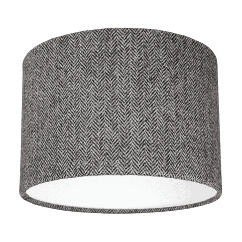 Cut out shot of a grey tweed drum shade with herringbone weave.