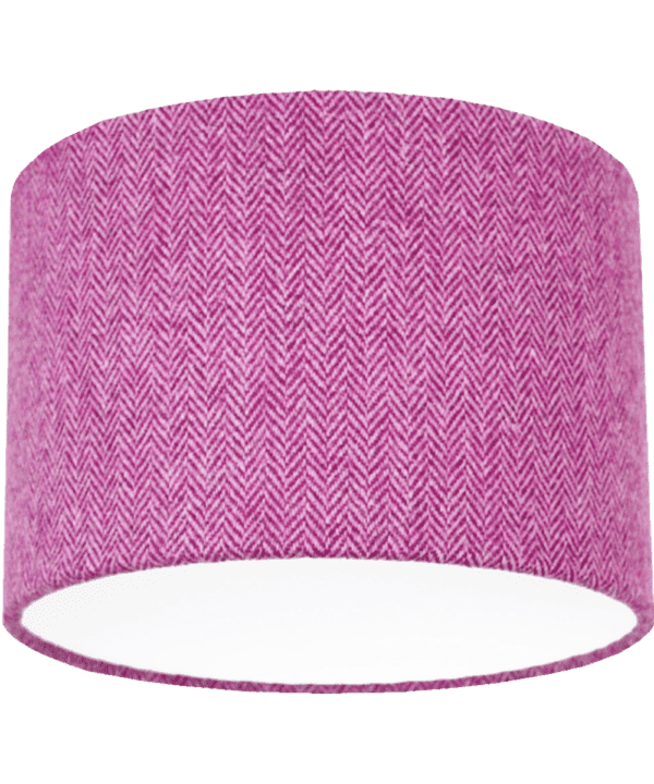 Cut out shot of a pink tweed drum shade with herringbone weave.