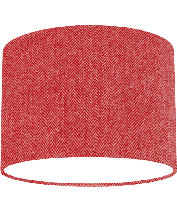 Cut out shot of a red tweed drum shade with herringbone weave.