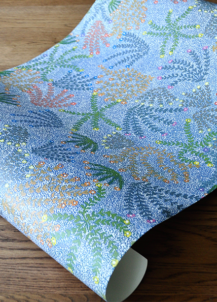A sample of 'Michelle' floral Aboriginal symbols wallpaper in blue, available at Telescope Style.