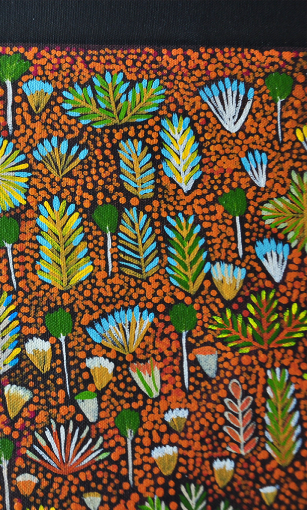 A detail of the 'Daisy' Aboriginal art wallpaper in brown.