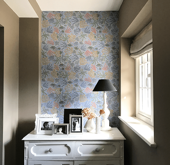 Styled shot of a hallway with feature wall in 'Michelle' Aboriginal symbols wallpaper in blue.