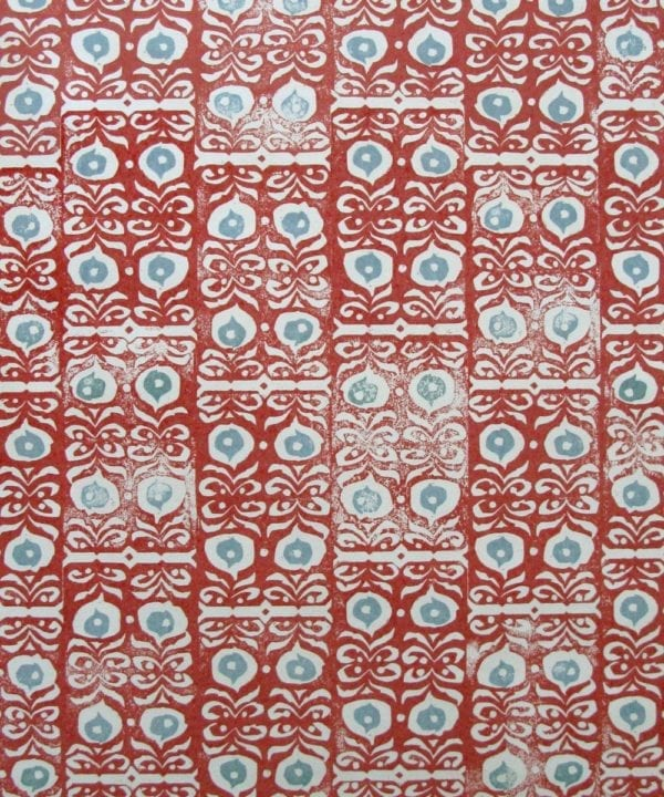 Fabric detail of 'Iznik' linen red patterned cushions.