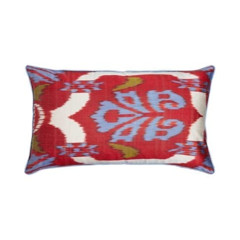 A red, blue and green rectangular ikat cushion measuring 40 x 60cm from Telescope Style.
