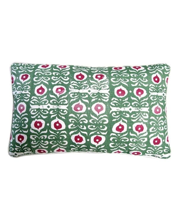 A rectangular printed linen cushion inspired by middle eastern pattern in red and green.