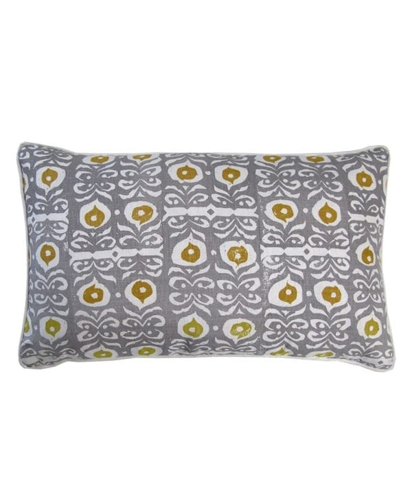 Grey patterned cushions with acid yellow accents depicting a stylised, Middle Eastern motif on hand-printed linen.