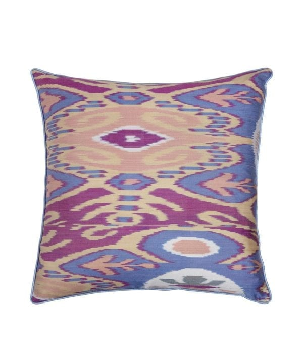 A 50cm x 50cm silk ikat cushion in pale blue, peach and purple shown as a cut out shot.