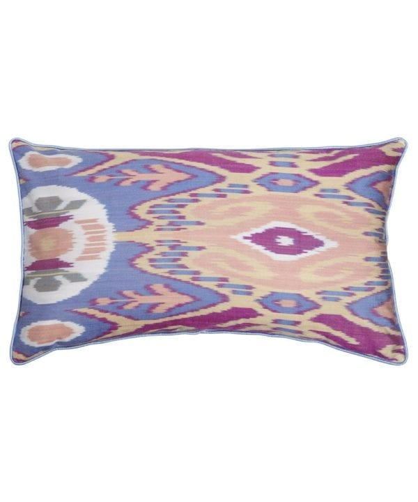 A 60cm x 40cm silk ikat cushion in pale blue, peach and purple shown as a cut out shot.